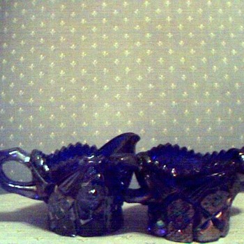 Dark blue, believe carnival glass, diamond cut on top, etc. creamer & sugar bowl. Can't find name to save my life. Someone HELP - Glassware