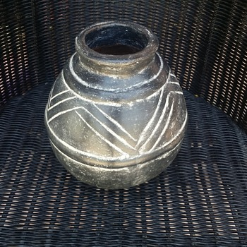 Style and approx age of this black old pottery???