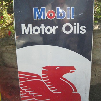 Mobil Motor Oils and Pennzoil signs