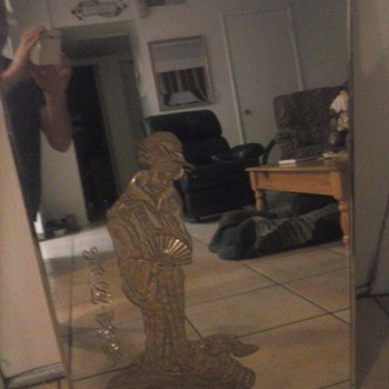 mirror with asian women on it gold leafed