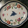 Small Plate with Raised Floral Decoration inside it