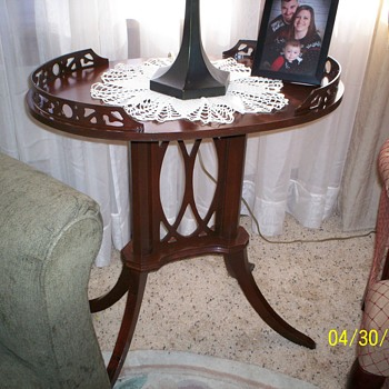 lamp table with carved set in along top
