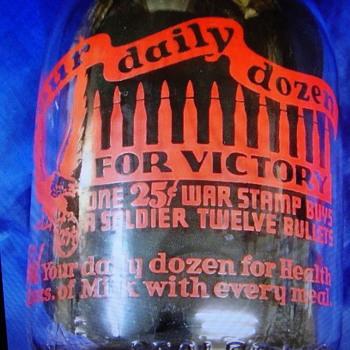 LARSON'S QUART MILK BOTTLE WITH RARE WAR SLOGAN..... - Bottles