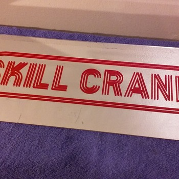 plastic SKILL CRANE mirrored name panel from an arcade machine - Advertising