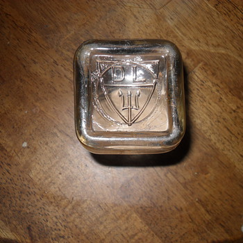 Small Glass jar with embossing on the bottom? - Bottles