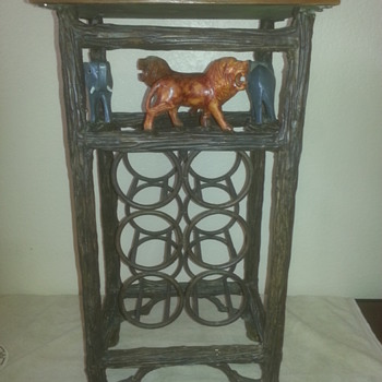 Metal Wine Rack with Elephant and Lion Carvings