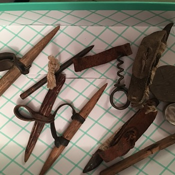 Old tools and vintage tin they were found in