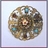 19s Enameled Filigree Vermeil Brooch with little turkoois and garnet