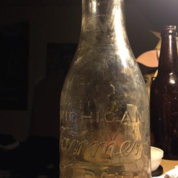 Glass milk bottle from Michigan farmers dairy 1 quart.