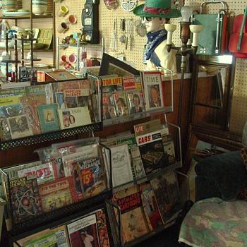 old magazine racks...possibly barber shop or beauty shoppe?