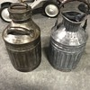 Two  Ellesco 5 gallon oil cans from the 1900's