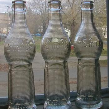 Three SMILE bottles ...ART DECO 1922...ALWAYS GOOD DAY DIGGING! - Bottles