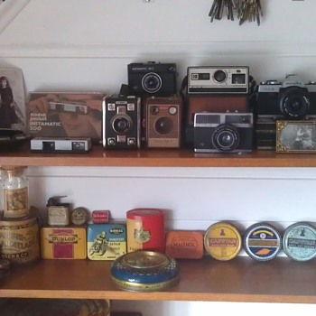 My  Vintage Camera and Advertising Tins Collection.