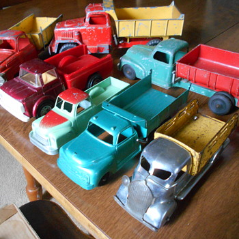 assorted toy trucks - Model Cars