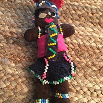 Stuffed and Beaded Black Doll looks handmade - Dolls