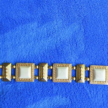 Heavy gold tone safet clasp bracelet.