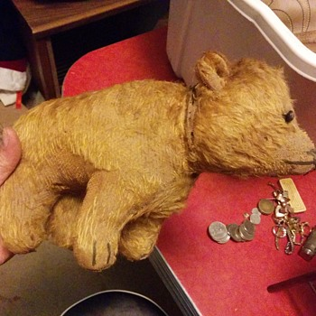 Early stuffed bear. Stomach is split. Has a chain and collar