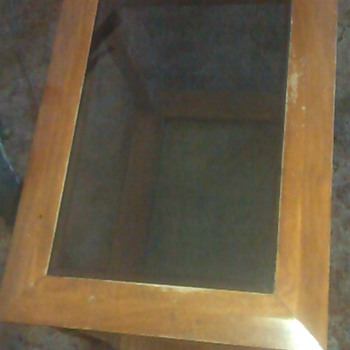Haunted Wooden Table with Glass Panel