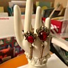 Clip on Earrings with Red Stones....is this Vintage?