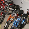 Minibikes at a long closed cycle & engine store in S. Minnesota