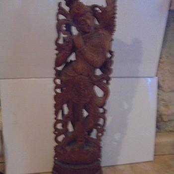 Sandalwood statue  -is it  Hindhu ?