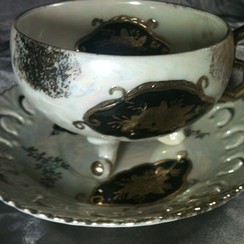 Gold and black Rainbow glass china cup and saucer  - China and Dinnerware