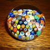 Clichy millefiori paperweight with a close pack of crafted flowers