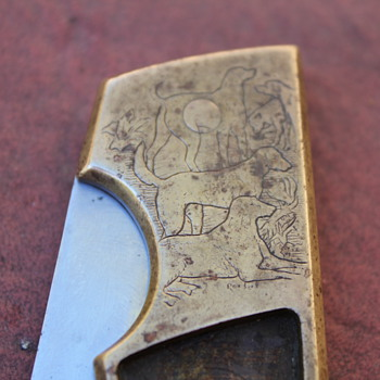 vintage Buck 110 with dog engravings