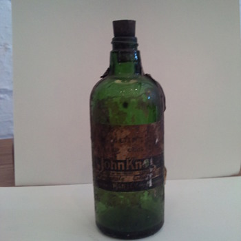 Dark Green Chemist Bottle with original lable,