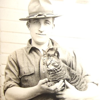 Soldier holding his pet cat rppc - Military and Wartime