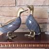 brass and art glass ducks.
