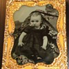 Nicely tinted ambrotype of child with hidden mother