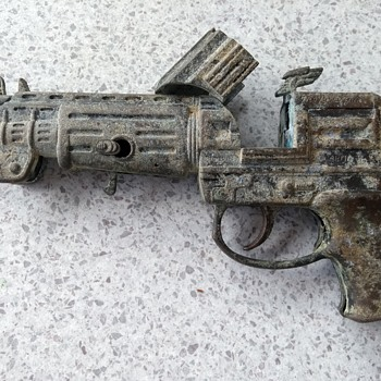 trying to ID This Old metal Toy gun  - Toys