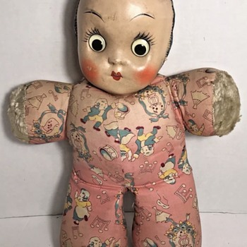 Cloth doll with plastic face? - Dolls