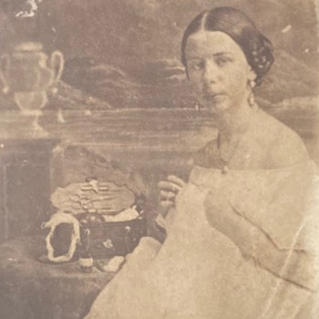 Early cdv of woman displaying her sewing kit - Photographs