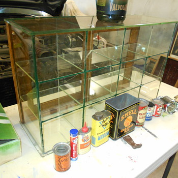 odd glass counter-top display case - Advertising
