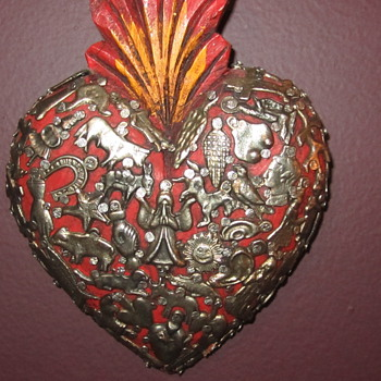 Wooden Art Heart covered in medallions/badges of many different things