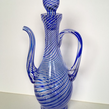 I need help in identifying the signature of this beautiful 28cm blue swirl glass ewer - Art Glass
