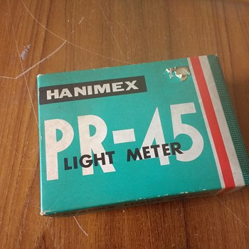Hanimex PR-45 Lightmeter in original packing with its shaped zipped leather case.