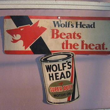 WOLF'S HEAD OIL CARDBOARD SIGN - Petroliana