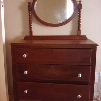 Dressing table with oval mirror