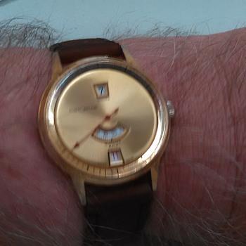 Oddball jump hour customtime Swiss watch