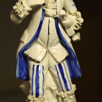 Porcelain Guy with Lacy Cuffs - Figurines