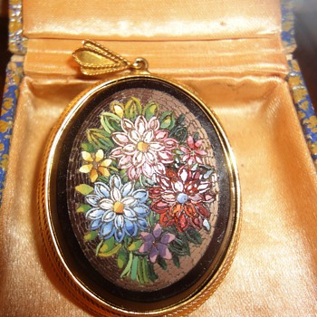 Large oval Micro Mosaic flower pendant mounted in yellow gold