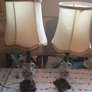 Antique lamps with white base and flowers