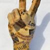 Papier-mache peace gesture