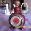 wooden doll clock