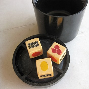 Bakelite dice and gaming pieces in WW2 bakelite fuse container - Games