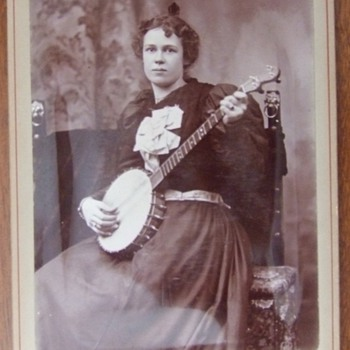 Cabinet card of a woman with her Banjo c. 1890 - Photographs