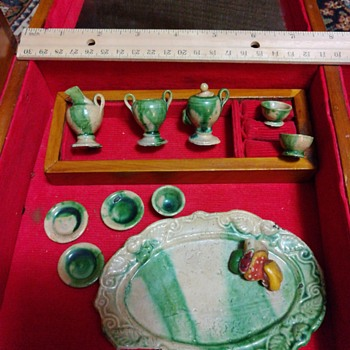 Miniature clay child's toy tea set
